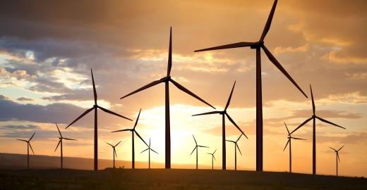 21076805 - wind turbines generating electricity on sunset sky
